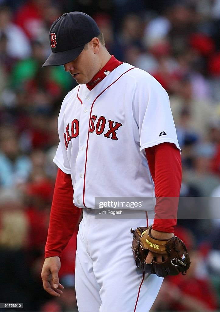 Pitcher Jonathan Papelbon of the Boston Red Sox reacts after allowing three runs in the ninth inning to blow the save against the Los Angeles Angels...