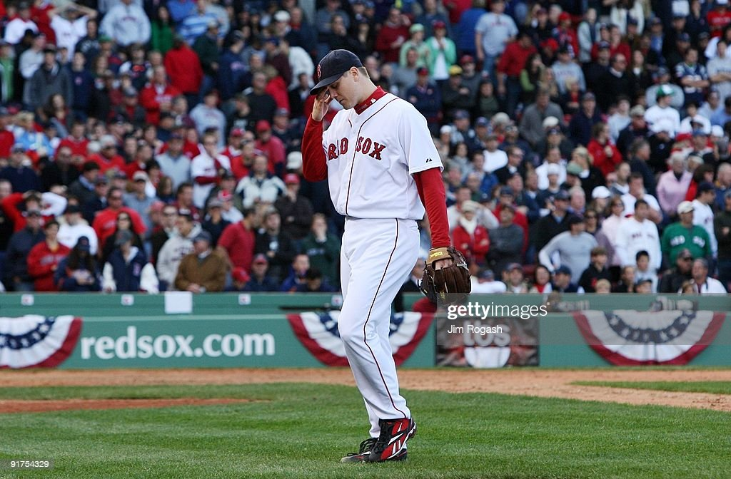 Pitcher <a gi-track='captionPersonalityLinkClicked' href=/galleries/search?phrase=Jonathan+Papelbon&family=editorial&specificpeople=453535 ng-click='$event.stopPropagation()'>Jonathan Papelbon</a> #58 of the Boston Red Sox reacts after being taken out of the game after blowing a save in the ninth inning against the Los Angeles Angels of Anaheim in Game Three of the ALDS during the 2009 MLB Playoffs at Fenway Park on October 11, 2009 in Boston, Massachusetts. The Angels defeated the Red Sox 7-6.