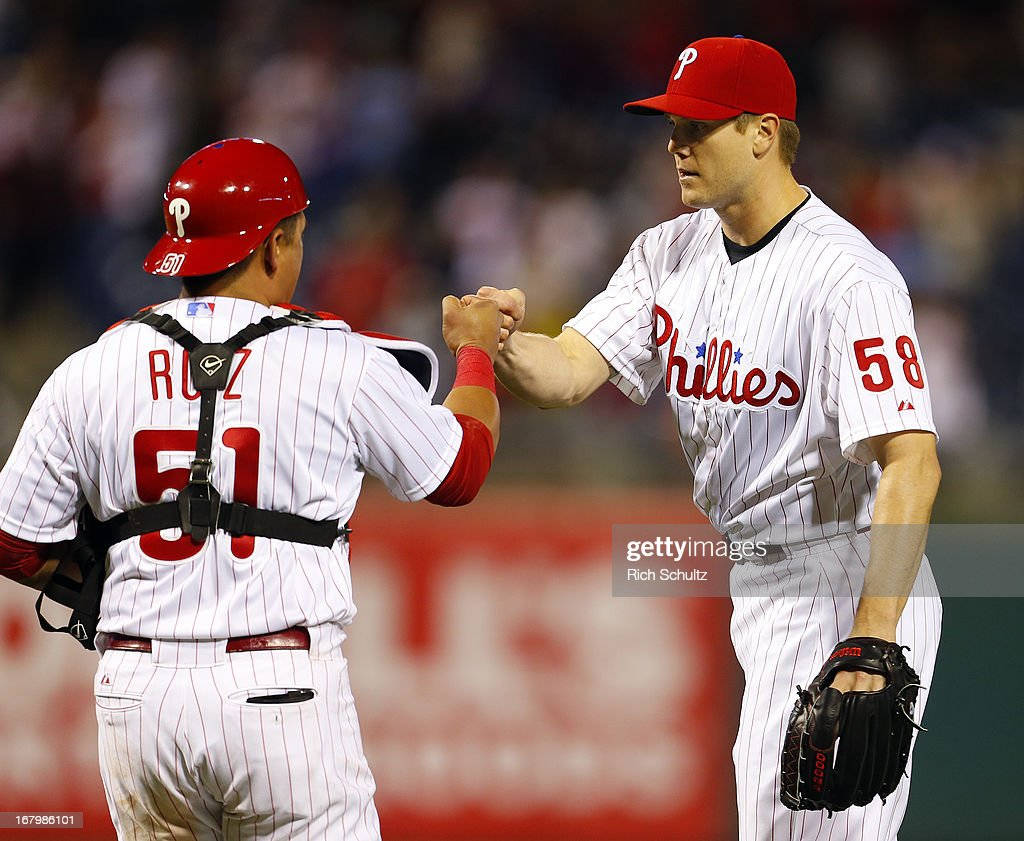 Pitcher <a gi-track='captionPersonalityLinkClicked' href=/galleries/search?phrase=Jonathan+Papelbon&family=editorial&specificpeople=453535 ng-click='$event.stopPropagation()'>Jonathan Papelbon</a> #58 of the Philadelphia Phillies is congratulated by catcher Carlos Ruiz #51after the Phillies defeated the Miami Marlins 4-1 on May 3, 2013 at Citizens Bank Park in Philadelphia, Pennsylvania.
