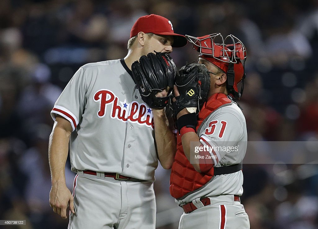 Pitcher <a gi-track='captionPersonalityLinkClicked' href=/galleries/search?phrase=Jonathan+Papelbon&family=editorial&specificpeople=453535 ng-click='$event.stopPropagation()'>Jonathan Papelbon</a> #58 of the Philadelphia Phillies talks with catcher Carlos Ruiz #51 in the ninth inning during the game against the Atlanta Braves at Turner Field on June 16, 2014 in Atlanta, Georgia.
