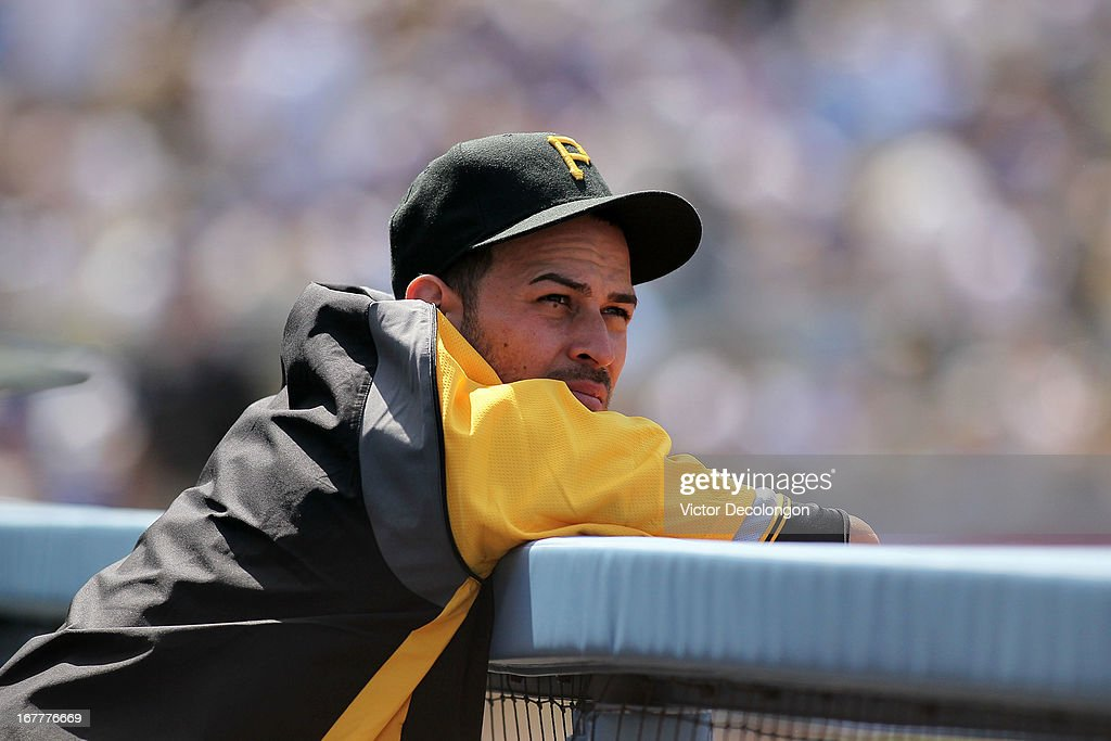 Pitcher <a gi-track='captionPersonalityLinkClicked' href=/galleries/search?phrase=Jonathan+Sanchez&family=editorial&specificpeople=534575 ng-click='$event.stopPropagation()'>Jonathan Sanchez</a> #57 of the Pittsburgh Pirates looks on from the dugout during the MLB game against the Los Angeles Dodgers at Dodger Stadium on April 7, 2013 in Los Angeles, California. The Dodgers defeated the Pirates 6-2.