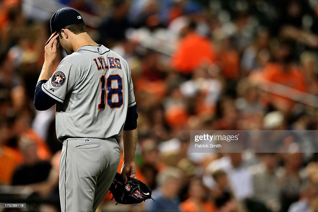 Pitcher <a gi-track='captionPersonalityLinkClicked' href=/galleries/search?phrase=Jordan+Lyles&family=editorial&specificpeople=7520081 ng-click='$event.stopPropagation()'>Jordan Lyles</a> #18 of the Houston Astros is relived in the sixth inning against the Baltimore Orioles at Oriole Park at Camden Yards on August 1, 2013 in Baltimore, Maryland. The Baltimore Orioles won, 6-3.