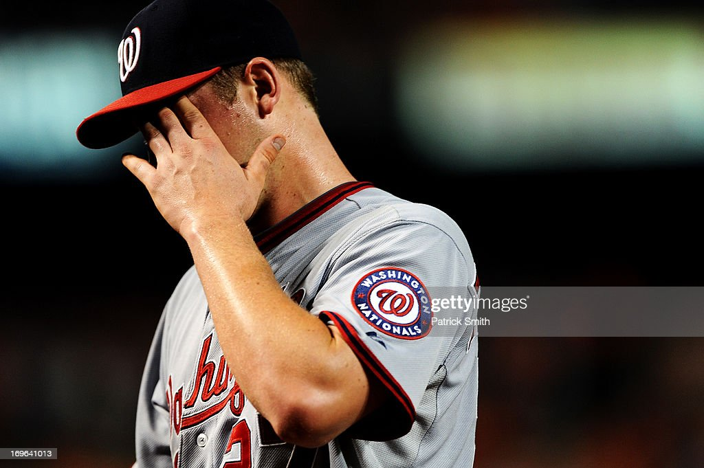 Pitcher Jordan Zimmermann #27 of the Washington Nationals is relieved in the seventh inning after giving up the tying run to the Baltimore Orioles during an interleague game at Oriole Park at Camden Yards on May 29, 2013 in Baltimore, Maryland. The Baltimore Orioles won, 9-6.