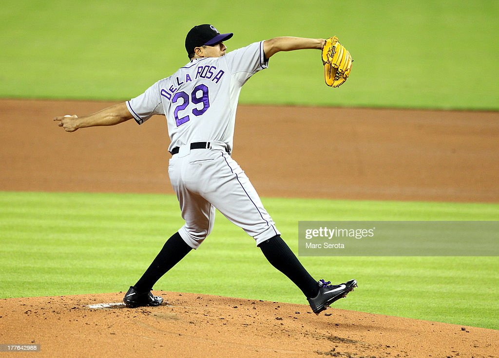Pitcher <a gi-track='captionPersonalityLinkClicked' href=/galleries/search?phrase=Jorge+De+La+Rosa&family=editorial&specificpeople=244046 ng-click='$event.stopPropagation()'>Jorge De La Rosa</a> #29 of the Colorado Rockies throws against the Miami Marlins at Marlins Park on August 25, 2013 in Miami, Florida.