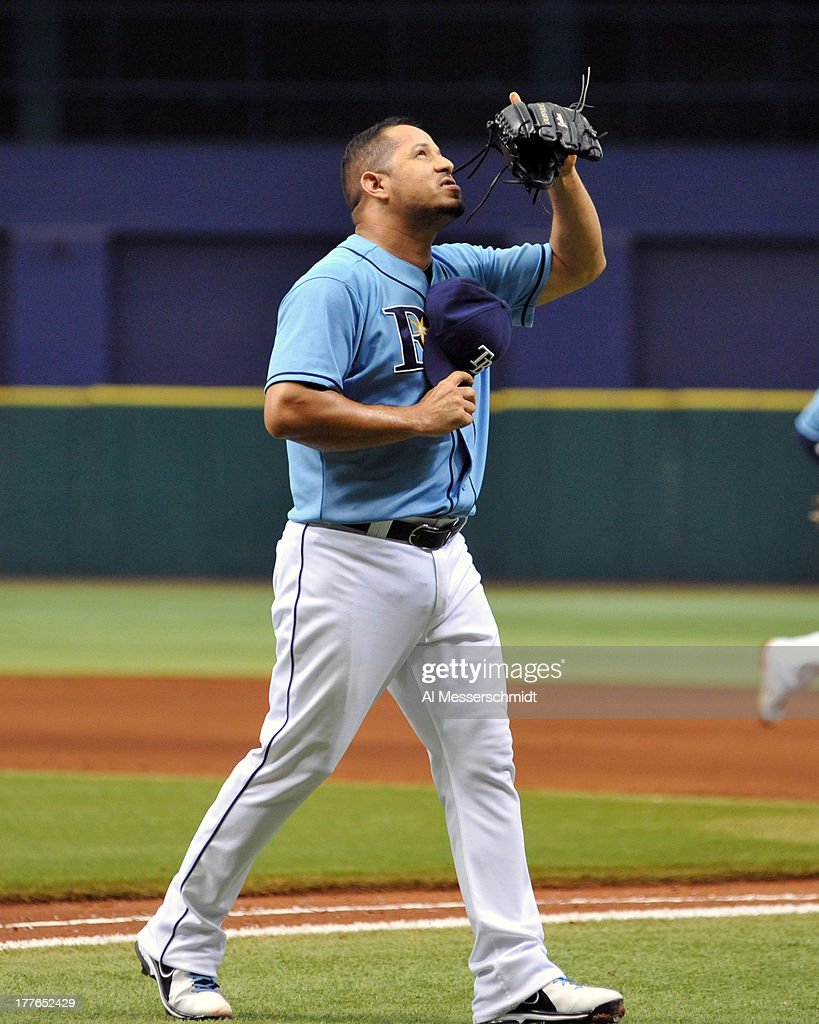 Pitcher Jose Peralta #62 of the Tampa Bay Rays celebrates after throwing in relief in the 8th inning against the New York Yankees August 25, 2013 at Tropicana Field in St. Petersburg, Florida.