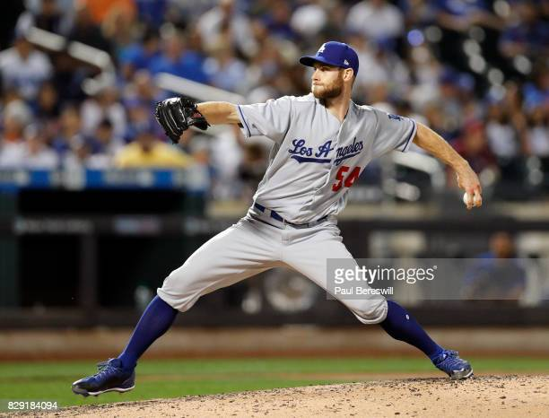 Pitcher Josh Bard of the Los Angeles Dodgers pitches in an MLB baseball game against the New York Mets on August 6 2017 at CitiField in the Queens...