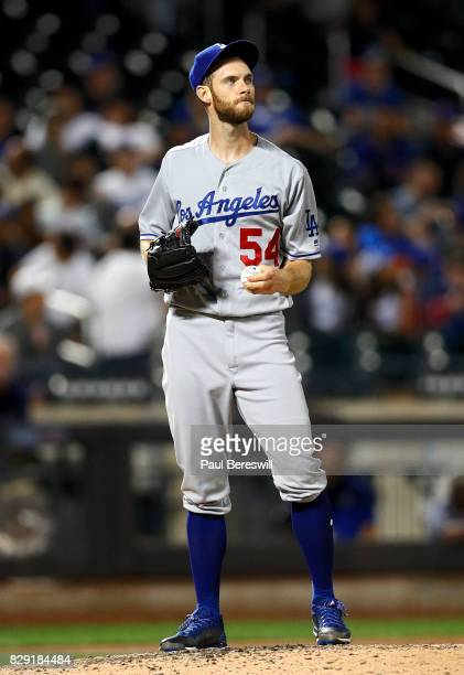 Pitcher Josh Bard of the Los Angeles Dodgers reacts in an MLB baseball game against the New York Mets on August 6 2017 at CitiField in the Queens...