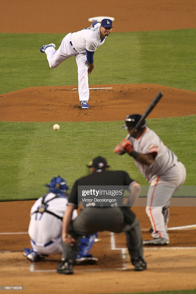 Pitcher <a gi-track='captionPersonalityLinkClicked' href=/galleries/search?phrase=Josh+Beckett&family=editorial&specificpeople=206314 ng-click='$event.stopPropagation()'>Josh Beckett</a> #61 of the Los Angeles Dodgers pitches to Pablo Sandoval #48 of the San Francisco Giants in the first inning during the MLB game at Dodger Stadium on April 3, 2013 in Los Angeles, California. The Giants defeated the Dodgers 5-3.