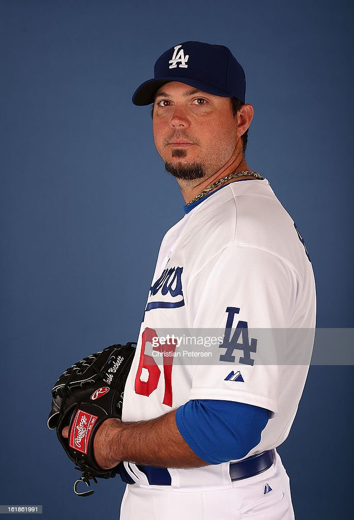 Pitcher <a gi-track='captionPersonalityLinkClicked' href=/galleries/search?phrase=Josh+Beckett&family=editorial&specificpeople=206314 ng-click='$event.stopPropagation()'>Josh Beckett</a> #2 of the Los Angeles Dodgers poses for a portrait during spring training photo day at Camelback Ranch on February 17, 2013 in Glendale, Arizona.
