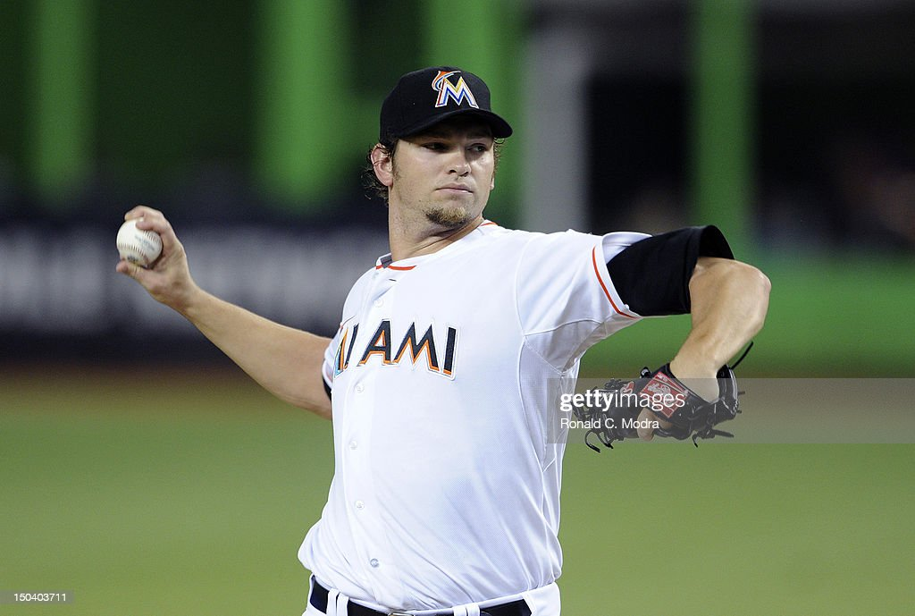 Pitcher <a gi-track='captionPersonalityLinkClicked' href=/galleries/search?phrase=Josh+Johnson&family=editorial&specificpeople=4166414 ng-click='$event.stopPropagation()'>Josh Johnson</a> #55 of the Miami Marlins pitches during a MLB game against the Philadelphia Phillies at Marlins Park on August 14, 2012 in Miami, Florida.