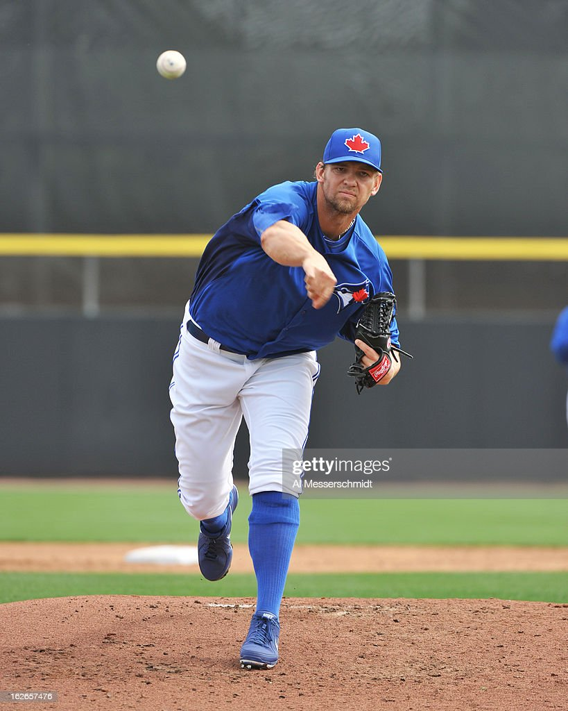 Pitcher Josh Johnson #55 of the Toronto Blue Jays throws in relief against the Boston Red Sox during a preason game February 25, 2013 at the Florida Auto Exchange Stadium in Dunedin, Florida.