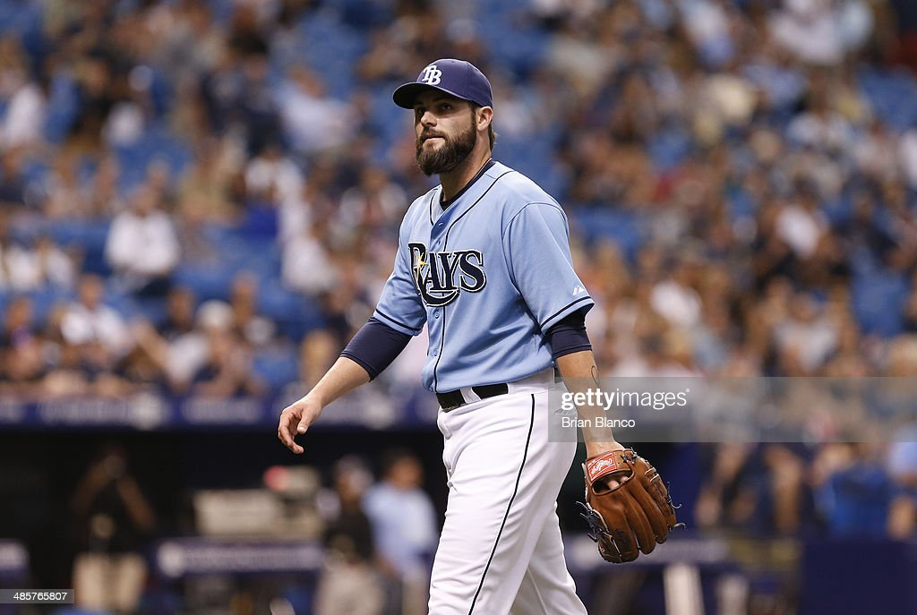 Pitcher Josh Lueke #52 of the Tampa Bay Rays walks off the field after the top of the 12th inning of a game against the New York Yankees on April 20, 2014 at Tropicana Field in St. Petersburg, Florida.