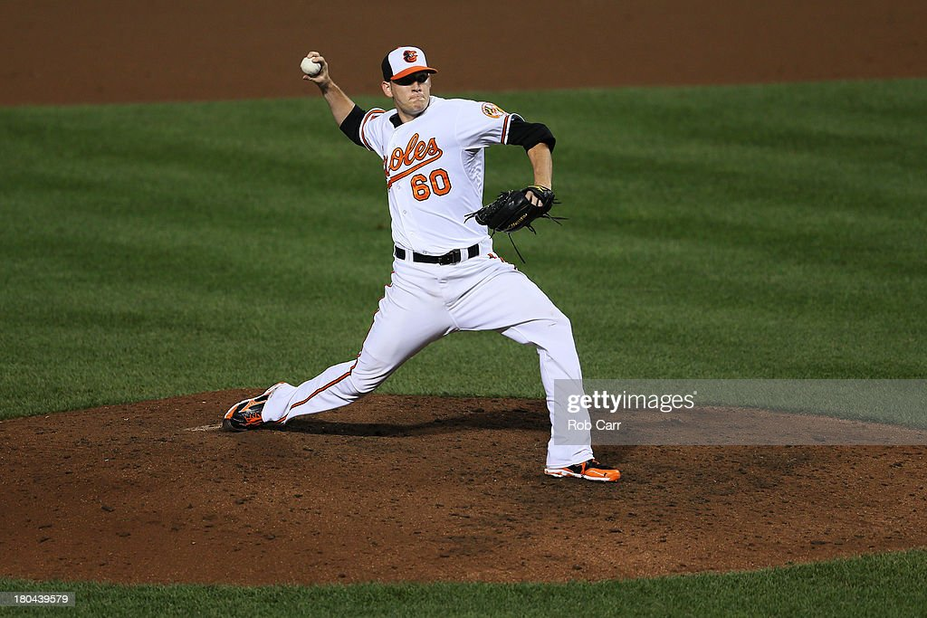 Pitcher Josh Stinson #60 of the Baltimore Orioles throws to a New York Yankees batter during the seventh inning at Oriole Park at Camden Yards on September 12, 2013 in Baltimore, Maryland.