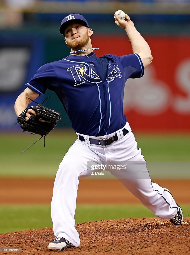 Pitcher <a gi-track='captionPersonalityLinkClicked' href=/galleries/search?phrase=J.P.+Howell&family=editorial&specificpeople=794363 ng-click='$event.stopPropagation()'>J.P. Howell</a> #39 of the Tampa Bay Rays pitches against the Oakland Athletics during the game at Tropicana Field on August 25, 2012 in St. Petersburg, Florida.