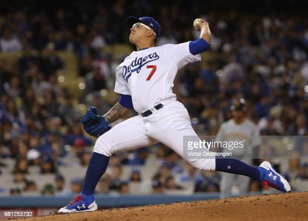Pitcher Julio Urias of the Los Angeles Dodgers pitches in the third inning during the MLB game against the Pittsburgh Pirates at Dodger Stadium on...