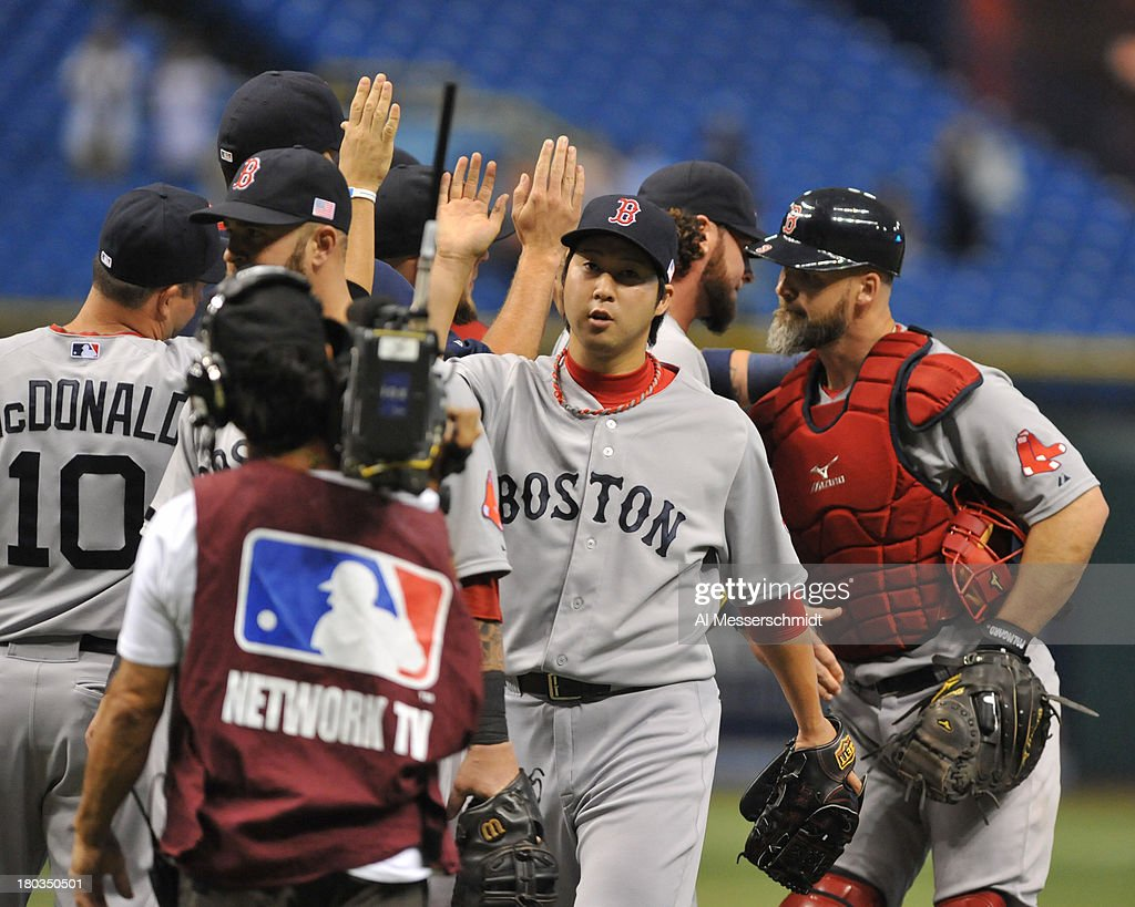 Pitcher <a gi-track='captionPersonalityLinkClicked' href=/galleries/search?phrase=Junichi+Tazawa&family=editorial&specificpeople=4624306 ng-click='$event.stopPropagation()'>Junichi Tazawa</a> #36 of the Boston Red Sox celebrates after a 7 - 3 win against the Tampa Bay Rays September 11, 2013 at Tropicana Field in St. Petersburg, Florida. Tazawa pitched in relief in the 10th inning.