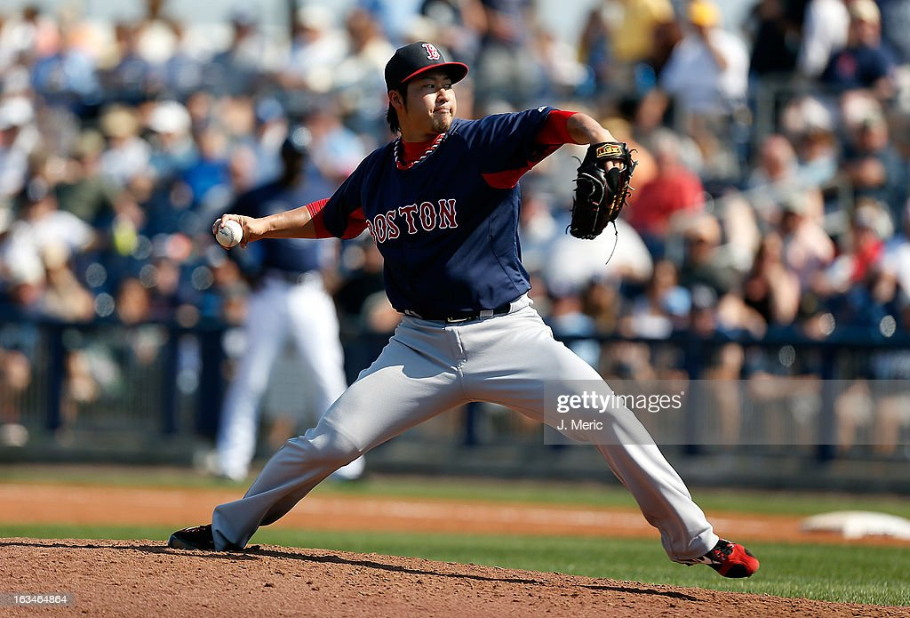 Pitcher <a gi-track='captionPersonalityLinkClicked' href=/galleries/search?phrase=Junichi+Tazawa&family=editorial&specificpeople=4624306 ng-click='$event.stopPropagation()'>Junichi Tazawa</a> #36 of the Boston Red Sox pitches against the Tampa Bay Rays during a Grapefruit League Spring Training Game at the Charlotte Sports Complex on March 10, 2013 in Port Charlotte, Florida.