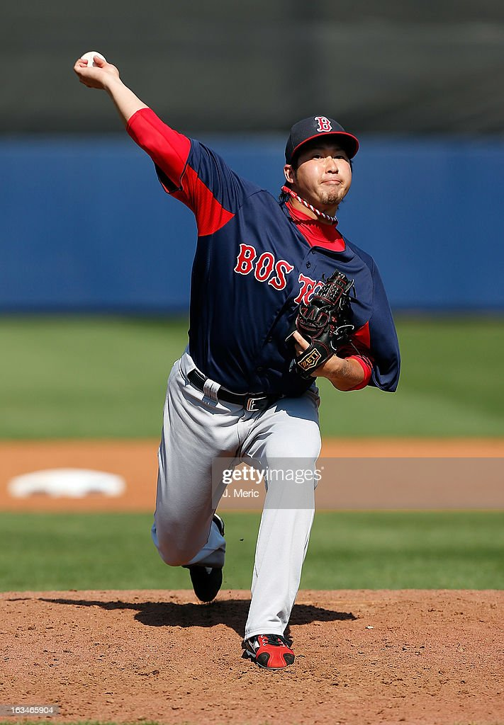 Pitcher Junichi Tazawa #36 of the Boston Red Sox pitches against the Tampa Bay Rays during a Grapefruit League Spring Training Game at the Charlotte Sports Complex on March 10, 2013 in Port Charlotte, Florida.