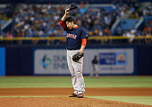 Pitcher Junichi Tazawa of the Boston Red Sox prepares to pitch during the seventh inning of a game against the Tampa Bay Rays on June 26 2015 at...