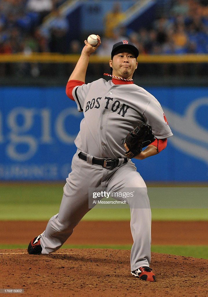 Pitcher <a gi-track='captionPersonalityLinkClicked' href=/galleries/search?phrase=Junichi+Tazawa&family=editorial&specificpeople=4624306 ng-click='$event.stopPropagation()'>Junichi Tazawa</a> #36 of the Boston Red Sox throws in relief against the Tampa Bay Rays June 10, 2013 at Tropicana Field in St. Petersburg, Florida.