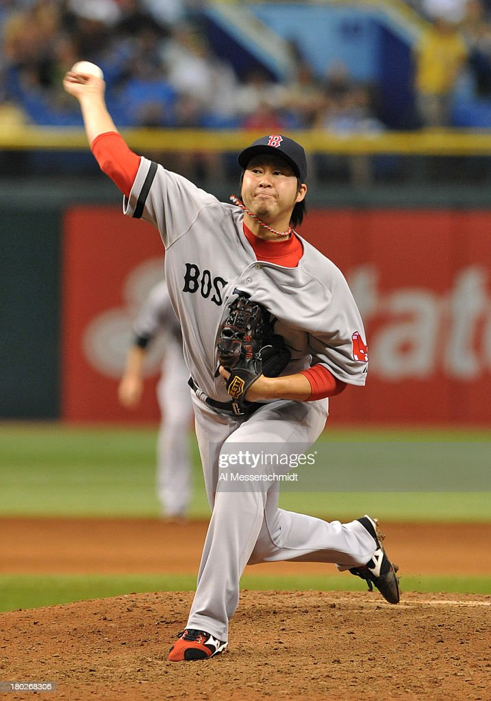 Pitcher <a gi-track='captionPersonalityLinkClicked' href=/galleries/search?phrase=Junichi+Tazawa&family=editorial&specificpeople=4624306 ng-click='$event.stopPropagation()'>Junichi Tazawa</a> #36 of the Boston Red Sox throws in relief in the 8th inning against the Tampa Bay Rays September 10, 2013 at Tropicana Field in St. Petersburg, Florida. Boston won 2 - 0.
