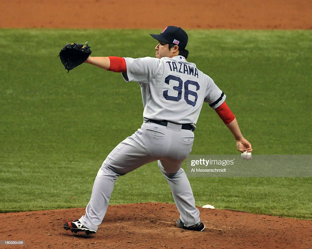 Pitcher <a gi-track='captionPersonalityLinkClicked' href=/galleries/search?phrase=Junichi+Tazawa&family=editorial&specificpeople=4624306 ng-click='$event.stopPropagation()'>Junichi Tazawa</a> #36 of the Boston Red Sox throws in relief in the tenth inning against the Tampa Bay Rays September 11, 2013 at Tropicana Field in St. Petersburg, Florida. Boston won 7 - 3.