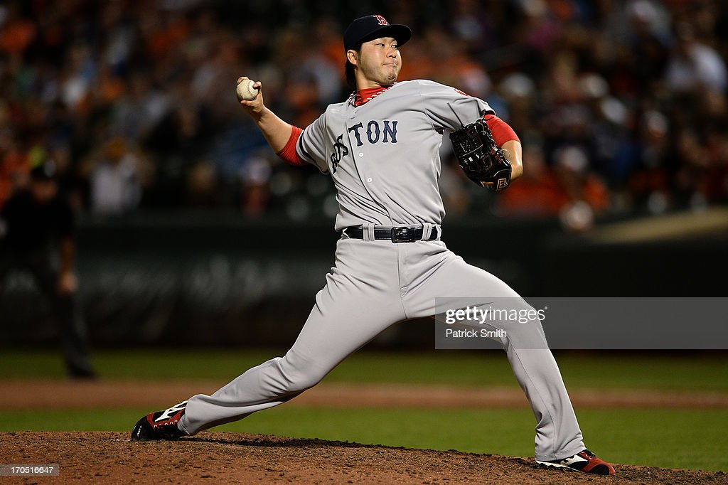 Pitcher <a gi-track='captionPersonalityLinkClicked' href=/galleries/search?phrase=Junichi+Tazawa&family=editorial&specificpeople=4624306 ng-click='$event.stopPropagation()'>Junichi Tazawa</a> #36 of the Boston Red Sox works the ninth inning against the Baltimore Orioles at Oriole Park at Camden Yards on June 13, 2013 in Baltimore, Maryland. The Baltimore Orioles won, 5-4, in 13-innings.