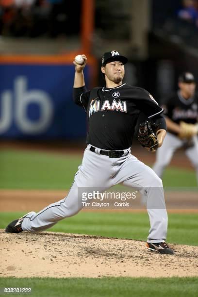 Pitcher Junichi Tazawa of the Miami Marlins pitching during the Miami Marlins Vs New York Mets regular season MLB game at Citi Field on August 19...
