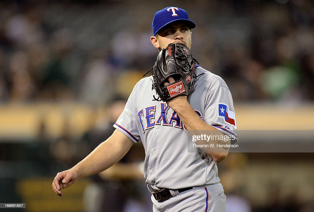 Pitcher <a gi-track='captionPersonalityLinkClicked' href=/galleries/search?phrase=Justin+Grimm&family=editorial&specificpeople=9480126 ng-click='$event.stopPropagation()'>Justin Grimm</a> #51 of the Texas Rangers walks back to the dugout after he was taken out of the game against the Oakland Athletics in the six inning at O.co Coliseum on May 13, 2013 in Oakland, California.