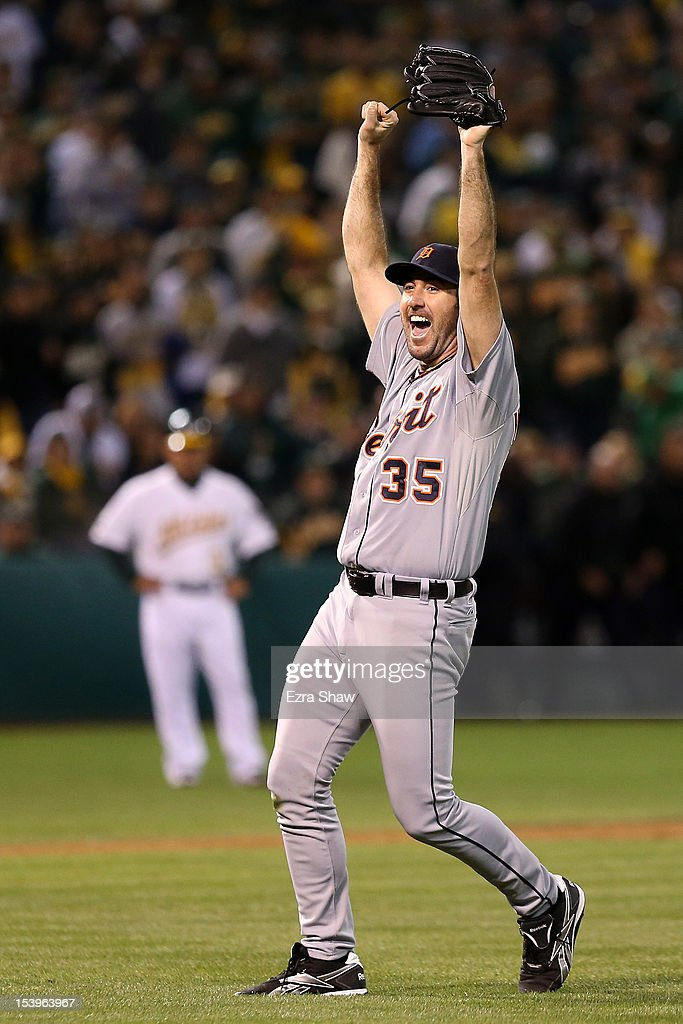 Pitcher <a gi-track='captionPersonalityLinkClicked' href=/galleries/search?phrase=Justin+Verlander&family=editorial&specificpeople=556723 ng-click='$event.stopPropagation()'>Justin Verlander</a> #35 of the Detroit Tigers celebrates after the Tigers defeat the Oakland Athletics 6-0 in Game Five of the American League Division Series at O.co Coliseum on October 11, 2012 in Oakland, California. Verlander pitched a complete gae shut out as the Tigers advance to the American League Championship Series.