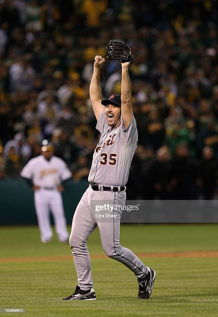 Pitcher <a gi-track='captionPersonalityLinkClicked' href=/galleries/search?phrase=Justin+Verlander&family=editorial&specificpeople=556723 ng-click='$event.stopPropagation()'>Justin Verlander</a> #35 of the Detroit Tigers celebrates after the Tigers defeat the Oakland Athletics 6-0 in Game Five of the American League Division Series at O.co Coliseum on October 11, 2012 in Oakland, California. Verlander pitched a complete game shut out as the Tigers advance to the American League Championship Series.