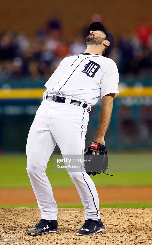 Pitcher Justin Verlander #35 of the Detroit Tigers reacts after giving up a double to Chris Iannetta of the Los Angeles Angels of Anaheim to end his no-hit bid during the ninth inning at Comerica Park on August 26, 2015 in Detroit, Michigan.