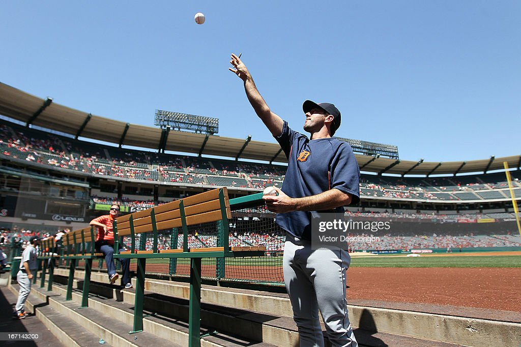 Pitcher Justin Verlander #35 of the Detroit Tigers throws a ball back to a fan after autgraphing the ball prior to the MLB game against the Los Angeles Angels of Anaheim at Angel Stadium of Anaheim on April 20, 2013 in Anaheim, California. The Angels defeated the Tigers 10-0.