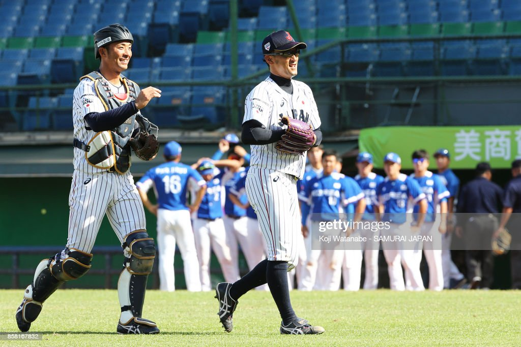 Pitcher Katsutoshi Satake (C) of Japan celebrate their 3-0 victory during the 28th Asian Baseball Championship Super Round match between Japan and South Korea at Hsing-Chuang Stadium on October 6, 2017 in New Taipei City, Taiwan.