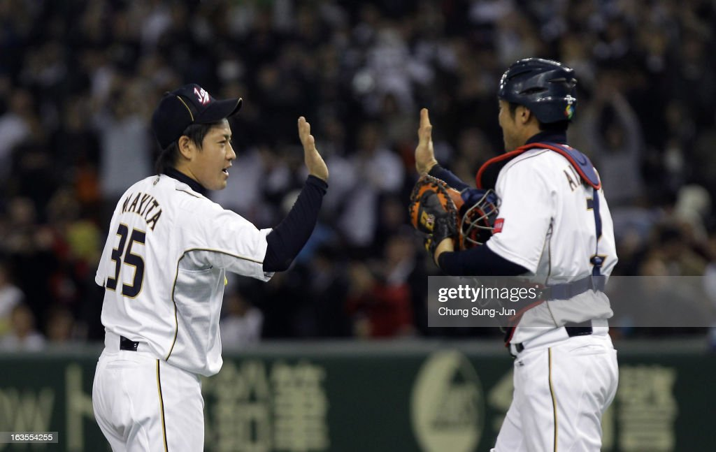 Pitcher Kazuhisa Makita #35 and catcher Ryoji Aikawa #2 of Japan celebrate victory over Netherlands in the World Baseball Classic Second Round Pool 1 game between Japan and the Netherlands at Tokyo Dome on March 12, 2013 in Tokyo, Japan.