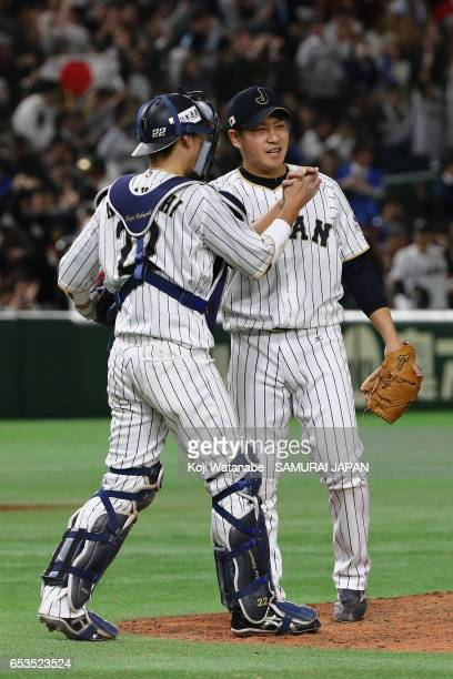Pitcher Kazuhisa Makita and Catcher Seiji Kobayashi of Japan celebrate after their win in the World Baseball Classic Pool E Game Six between Israel...