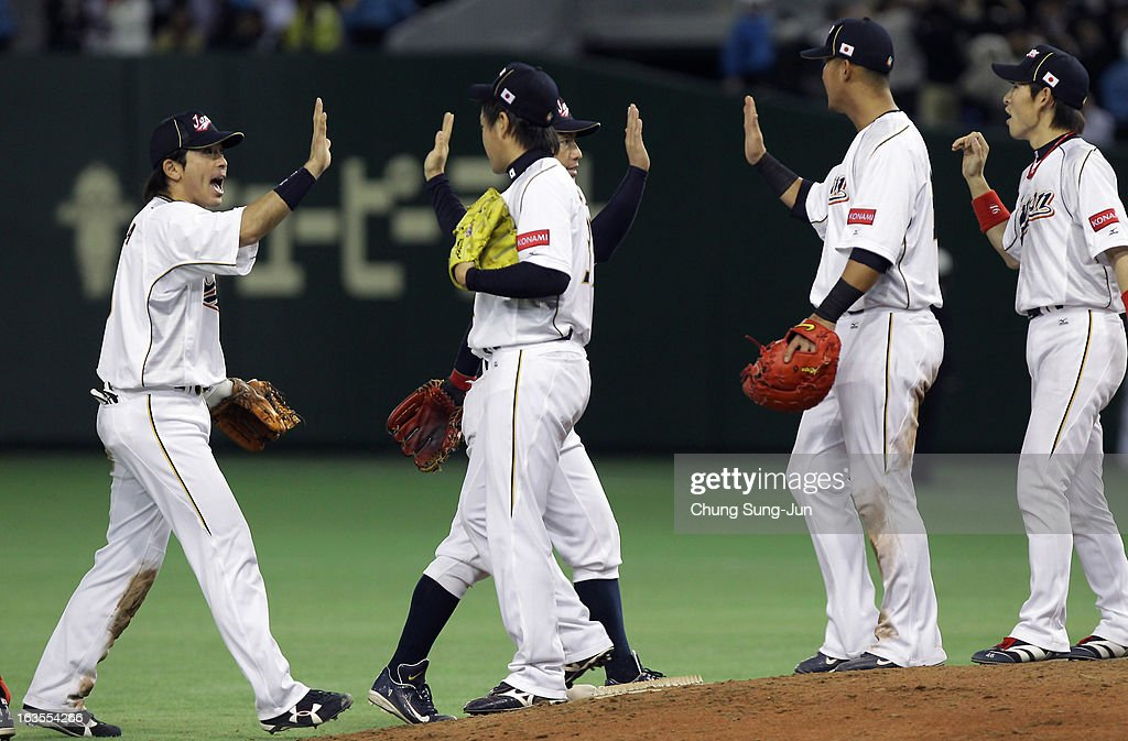 Pitcher <a gi-track='captionPersonalityLinkClicked' href=/galleries/search?phrase=Kazuhisa+Makita&family=editorial&specificpeople=10508674 ng-click='$event.stopPropagation()'>Kazuhisa Makita</a> #35 and <a gi-track='captionPersonalityLinkClicked' href=/galleries/search?phrase=Nobuhiro+Matsuda&family=editorial&specificpeople=8673842 ng-click='$event.stopPropagation()'>Nobuhiro Matsuda</a> #5 and other players of Japan celebrate victory over Netherlands in the World Baseball Classic Second Round Pool 1 game between Japan and the Netherlands at Tokyo Dome on March 12, 2013 in Tokyo, Japan.
