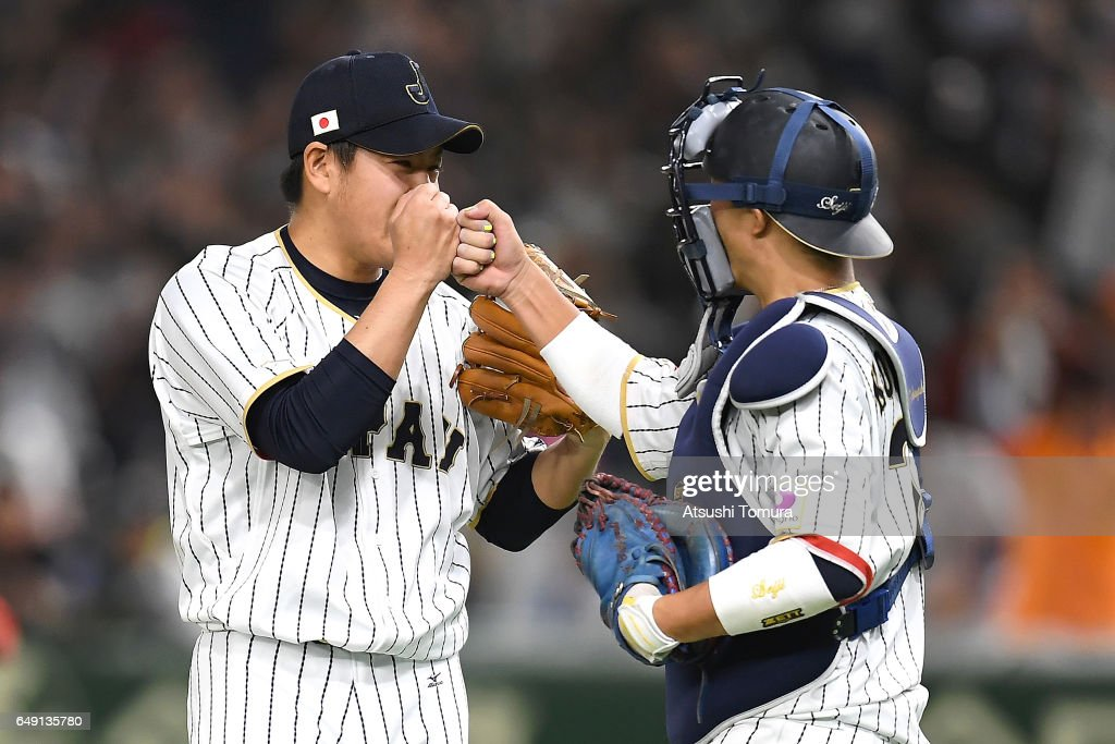 Pitcher Kazuhisa Makita #35 of Japan (L) celebrates with catcher Seiji Kobayashi #22 of Japan after winning the World Baseball Classic Pool B Game One between Cuba and Japan at Tokyo Dome on March 7, 2017 in Tokyo, Japan.