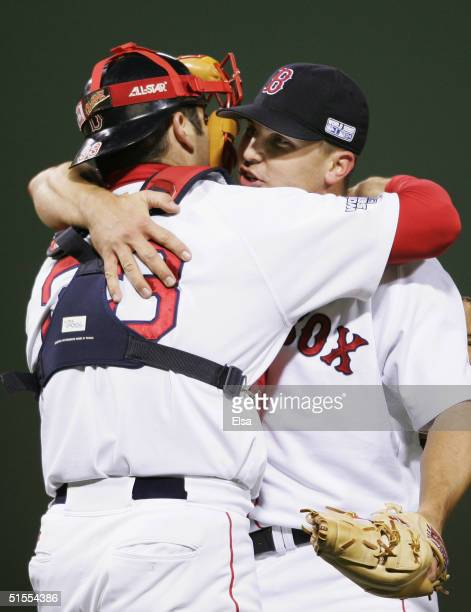 Pitcher Keith Foulke of the Boston Red Sox and Doug Mirabelli celebrate the 119 win over the St Louis Cardinals in game one of the World Series on...