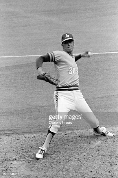 Pitcher Ken Holtzman of the Oakland A's delivers a pitch during game one of the World Series on October 14 1972 against the Cincinnati Reds at...