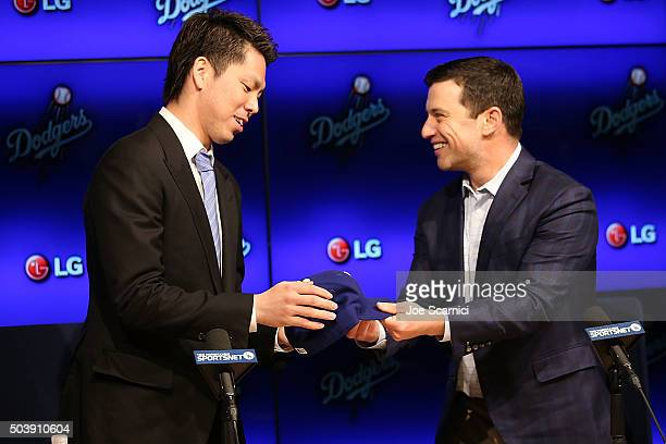 Pitcher Kenta Maeda is introduced to the Los Angeles Dodgers by Dodgers president of baseball operations Andrew Friedman at Dodger Stadium on January...