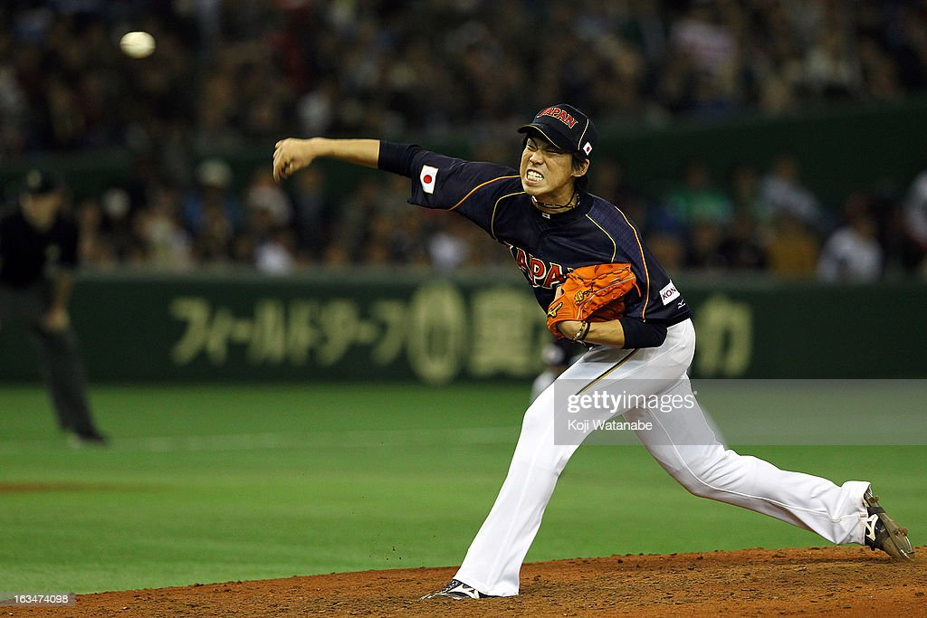 Pitcher <a gi-track='captionPersonalityLinkClicked' href=/galleries/search?phrase=Kenta+Maeda&family=editorial&specificpeople=10509788 ng-click='$event.stopPropagation()'>Kenta Maeda</a> #20 of Japan throws during the World Baseball Classic Second Round Pool 1 game between Japan and the Netherlands at Tokyo Dome on March 10, 2013 in Tokyo, Japan.