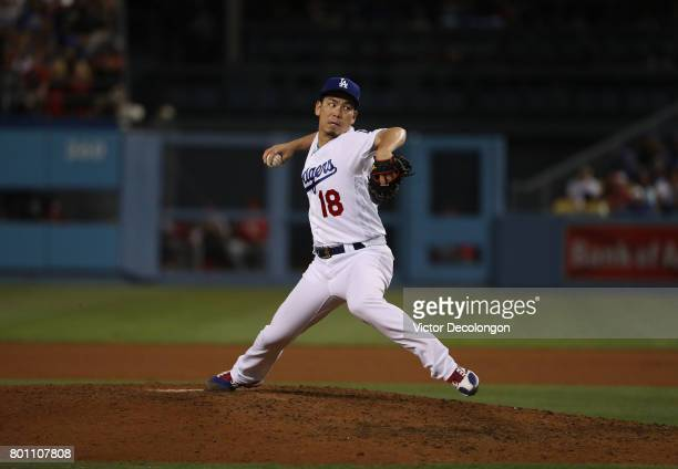 Pitcher Kenta Maeda of the Los Angeles Dodgers pitches in the sixth inning during the MLB game at Dodger Stadium on June 9 2017 in Los Angeles...