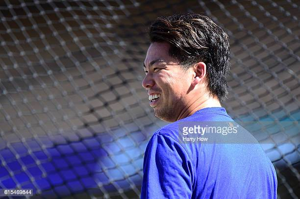 Pitcher Kenta Maeda of the Los Angeles Dodgers reacts during batting practice on the field prior to taking on the Chicago Cubs in game three of the...