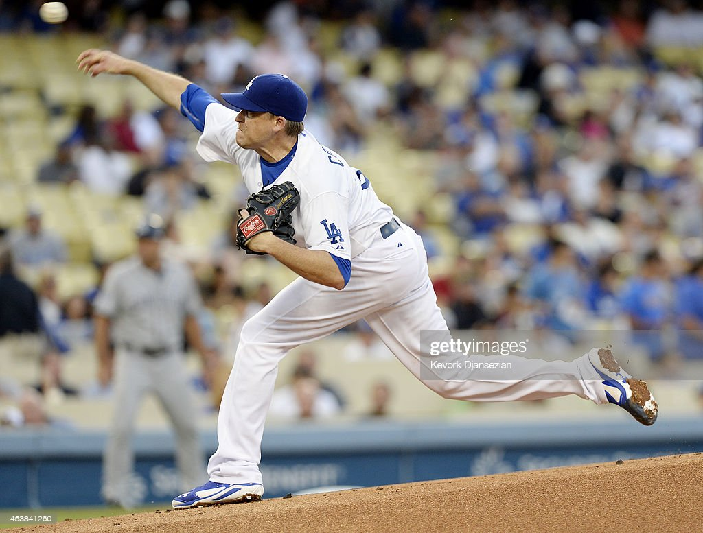 Pitcher Kevin Correia of the Los Angeles Dodgers throws against the San Diego Padres during the first inning of the baseball game August 19 at Dodger...