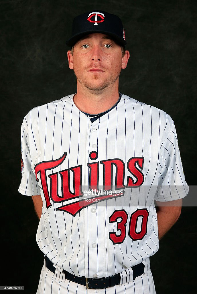 Pitcher Kevin Correia of the Minnesota Twins poses for a portrait at Hammond Stadium during photo day on February 25 2014 in Fort Myers Florida