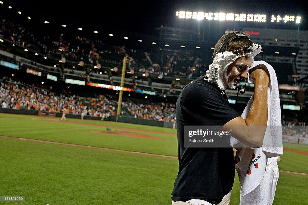 Pitcher Kevin Gausman #37 of the Baltimore Orioles wipes shaving cream from his face after he received his first major league win against the New York Yankees at Oriole Park at Camden Yards on June 28, 2013 in Baltimore, Maryland. The Baltimore Orioles won, 4-3.