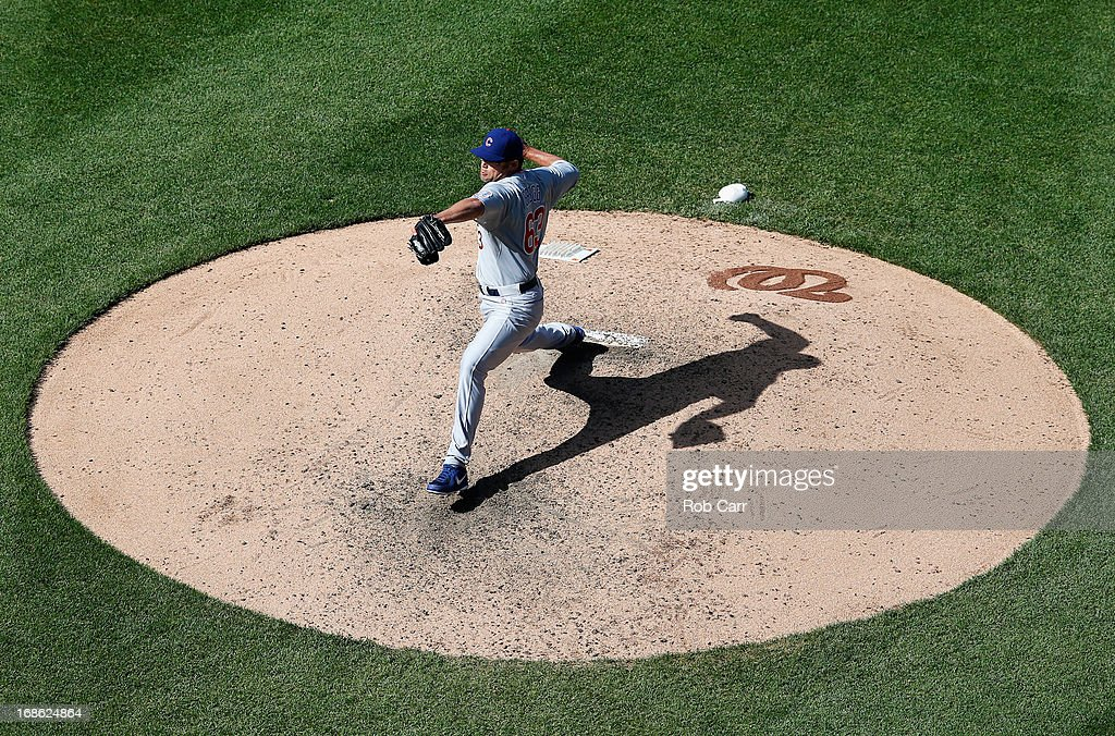 Pitcher <a gi-track='captionPersonalityLinkClicked' href=/galleries/search?phrase=Kevin+Gregg&family=editorial&specificpeople=240417 ng-click='$event.stopPropagation()'>Kevin Gregg</a> #63 of the Chicago Cubs throws to a Washington Nationals batter during the ninth inning of the Cubs 2-1 win at Nationals Park on May 12, 2013 in Washington, DC.