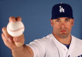 Pitcher Kevin Gregg of the Los Angeles Dodgers poses for a portrait during spring training photo day at Camelback Ranch on February 17 2013 in...
