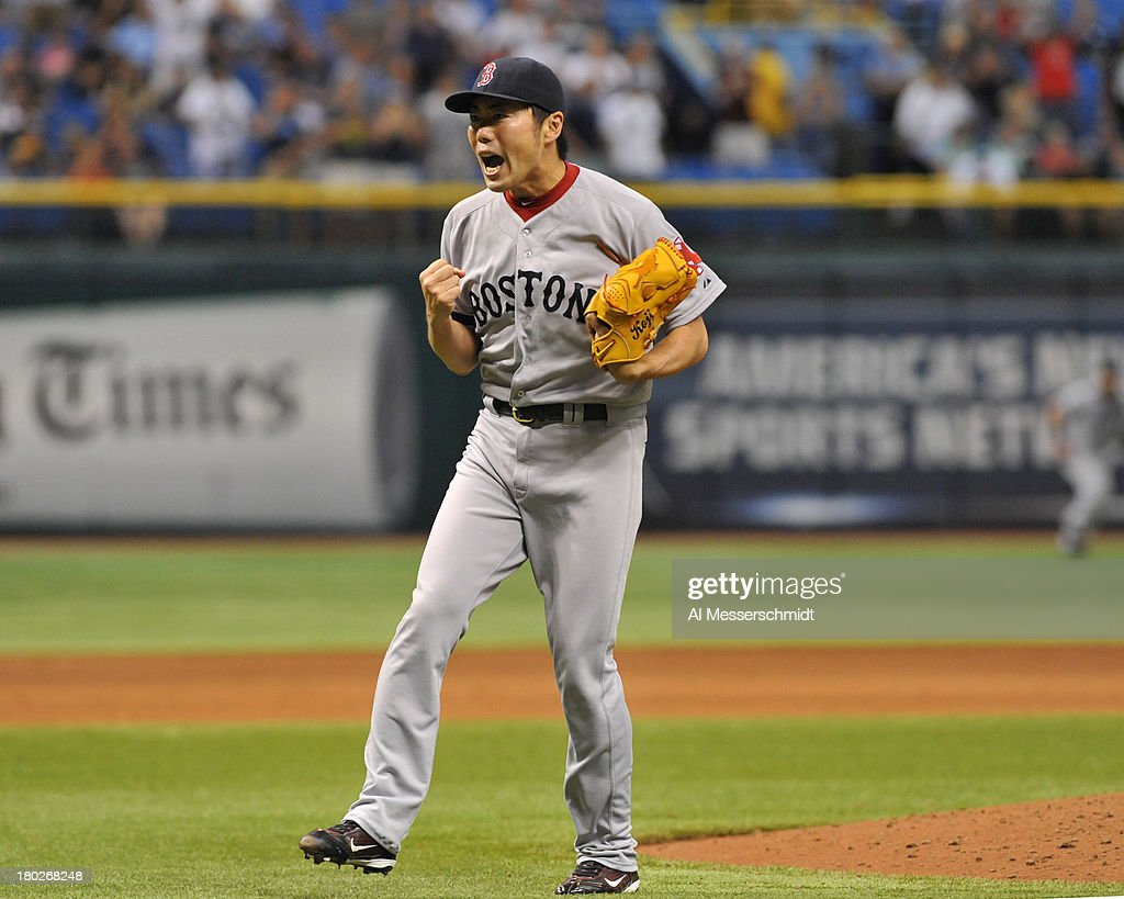 Pitcher Koji Uehara #19 of the Boston Red Sox celebrates after throwing in relief in the 9th inning against the Tampa Bay Rays September 10, 2013 at Tropicana Field in St. Petersburg, Florida. Boston won 2 - 0.